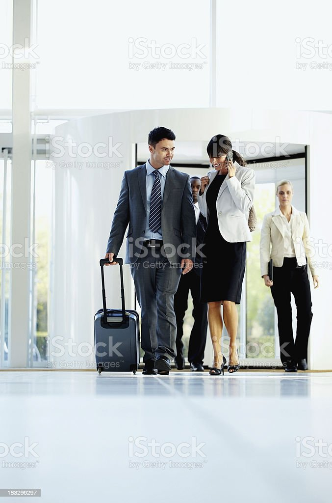 Successful business couple with team walking at an airport royalty-free stock photo