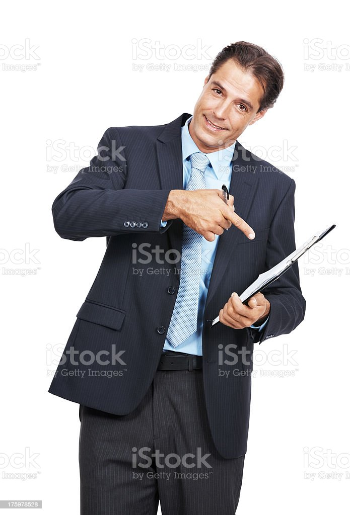 Successful business executive pointing at clipboard  stock photo