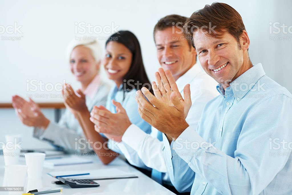 Successful business executives applauding at a conference stock photo