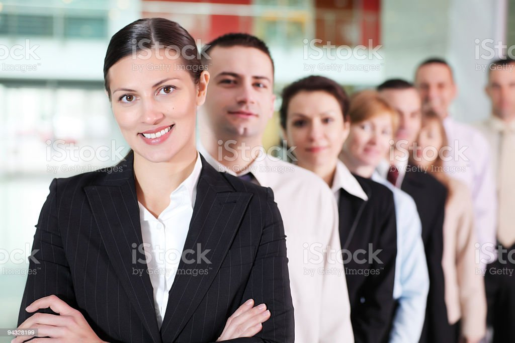 Successful business lady with her team. royalty-free stock photo