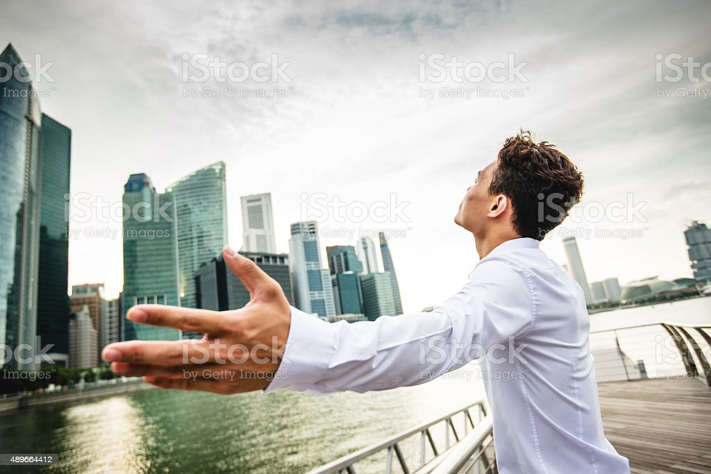 Successful business man against the skyscraper in singapore stock photo