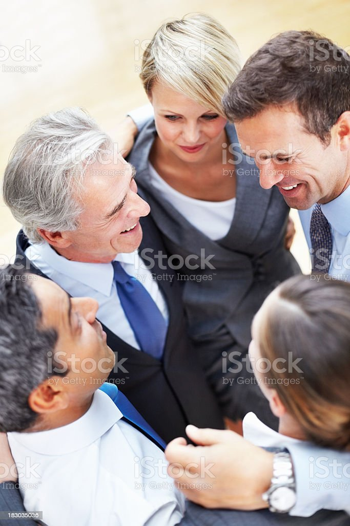 Successful business man and woman standing in a huddle royalty-free stock photo