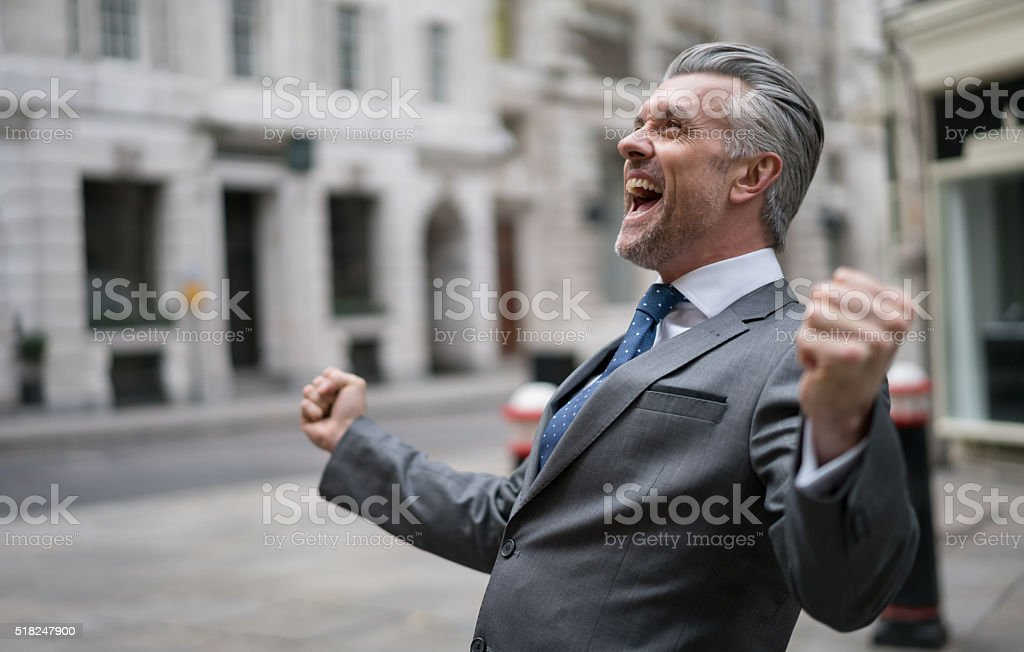 Successful business man celebrating stock photo