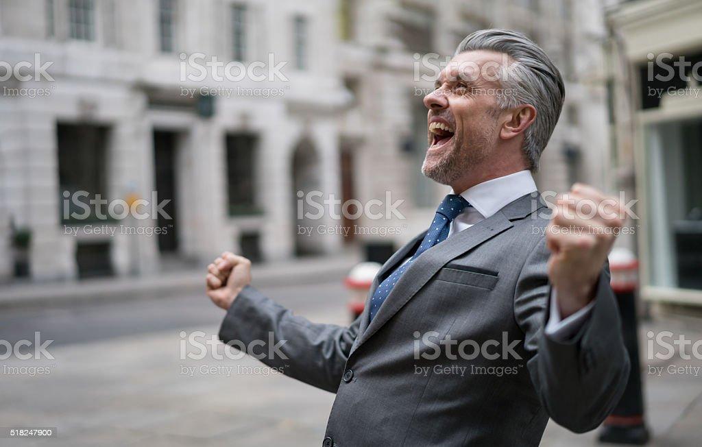 Successful business man celebrating stock photo