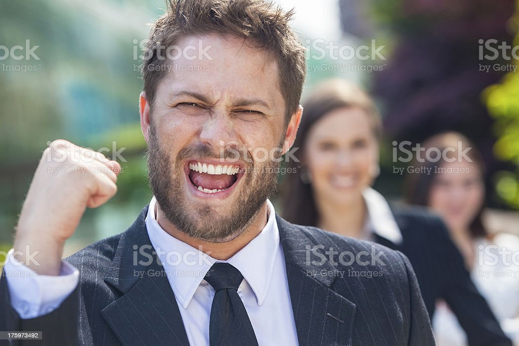 Successful Business Man Celebrating With Female Team royalty-free stock photo