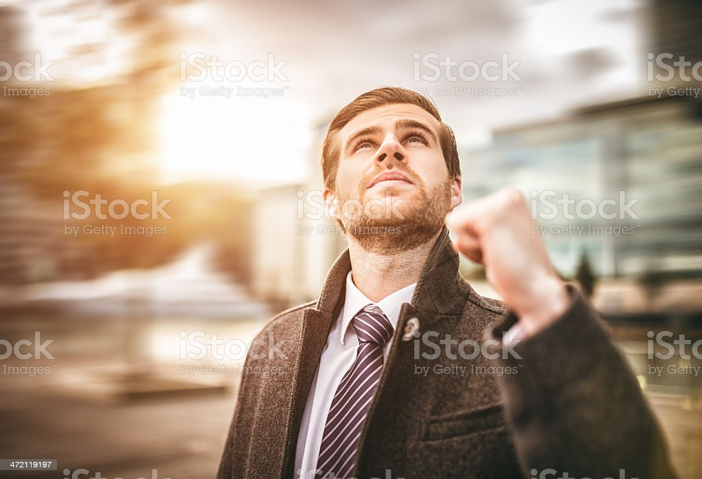 Successful business man cheering stock photo