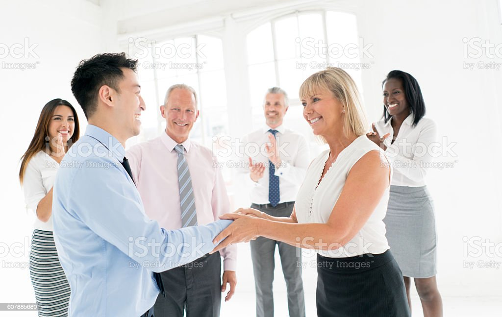 Successful business man getting a promotion stock photo