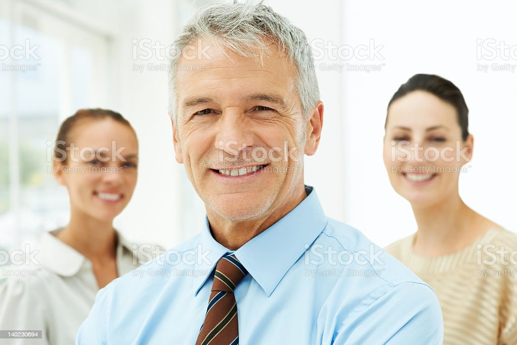Successful business man looking at you stock photo