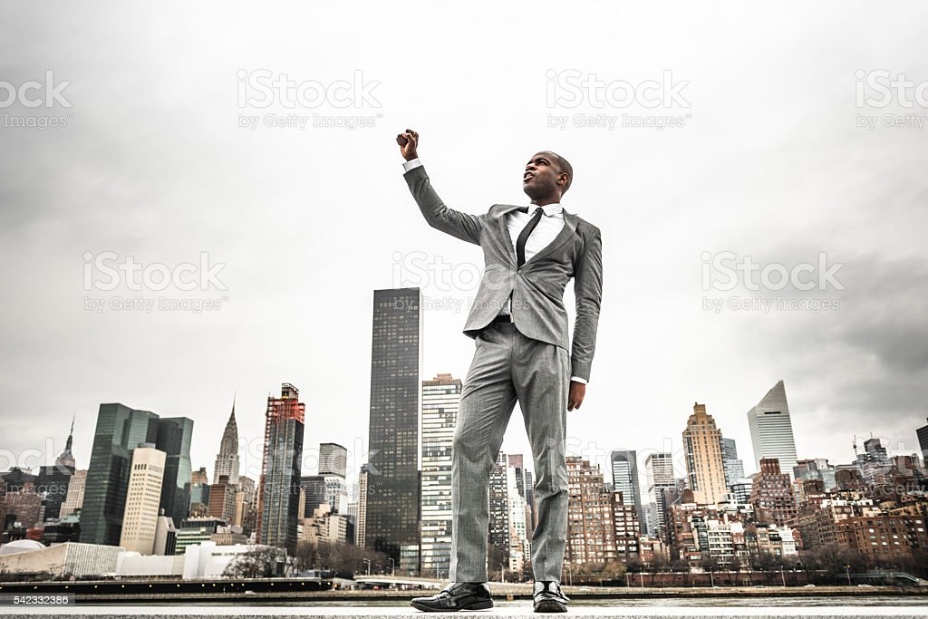Successful business man looking away against the skyline stock photo
