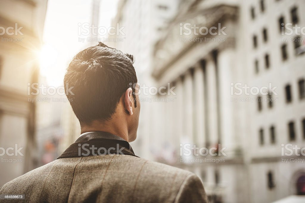 Successful business man looking wall street stock photo