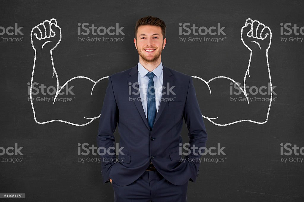 Successful business man on blackboard stock photo