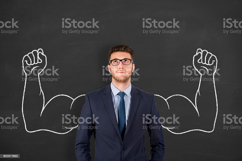 Successful business man on chalkboard background stock photo