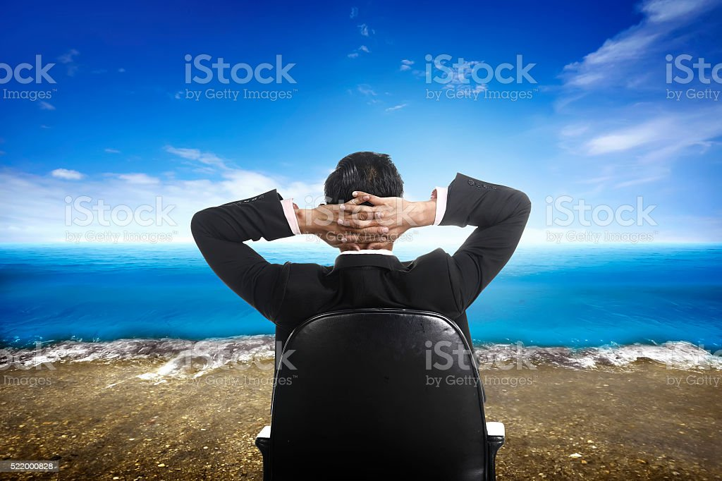 Successful business man on the beach stock photo