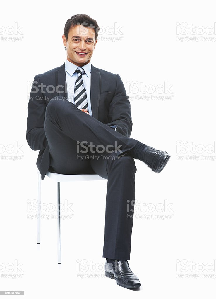Successful business man sitting and looking confident stock photo