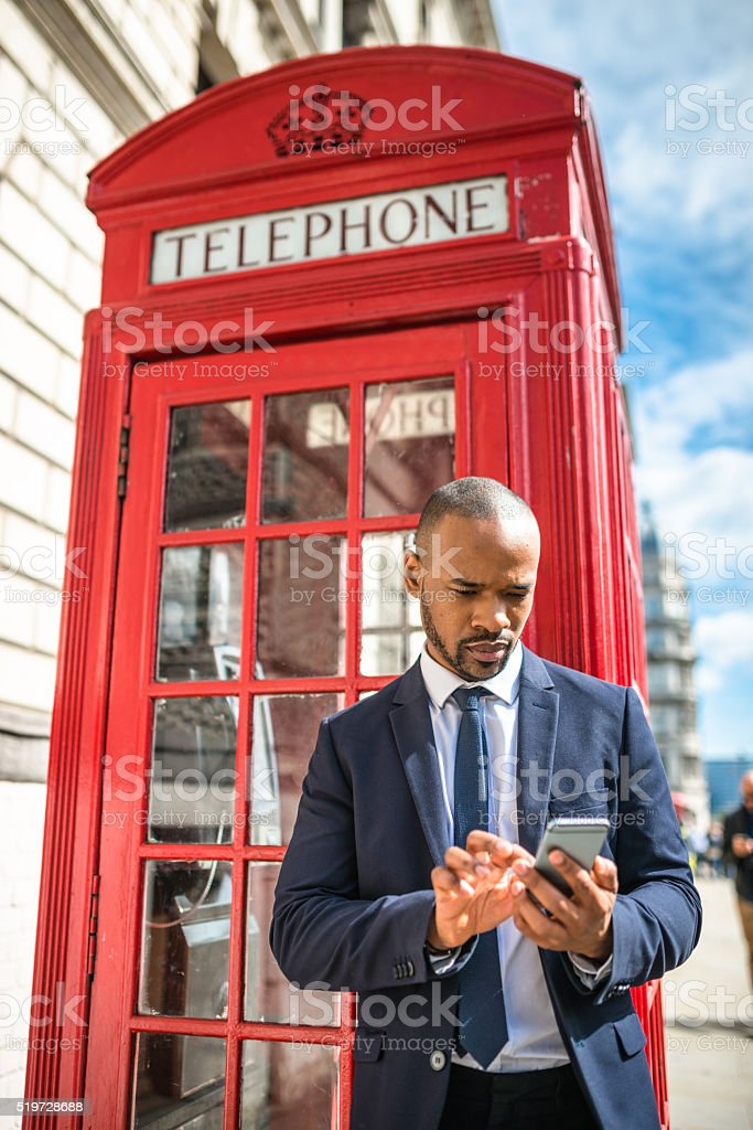 Successful business man smiling in London stock photo