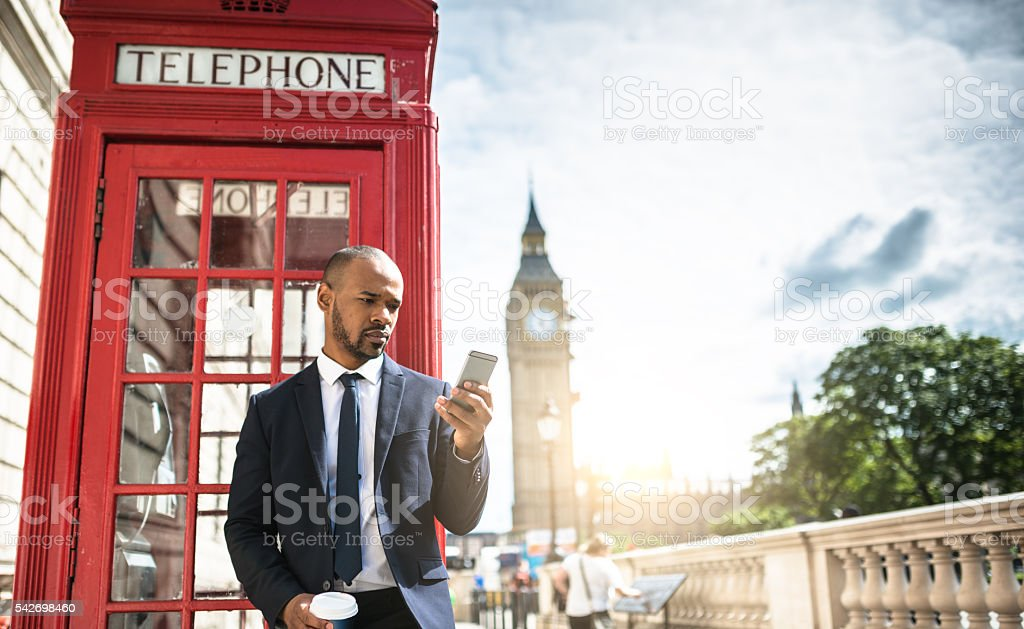 Successful business man text messaging stock photo