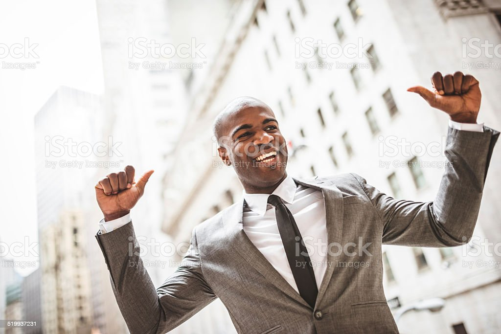 Successful business man with thumbs up stock photo