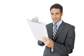 Successful business man writing on a clipboard