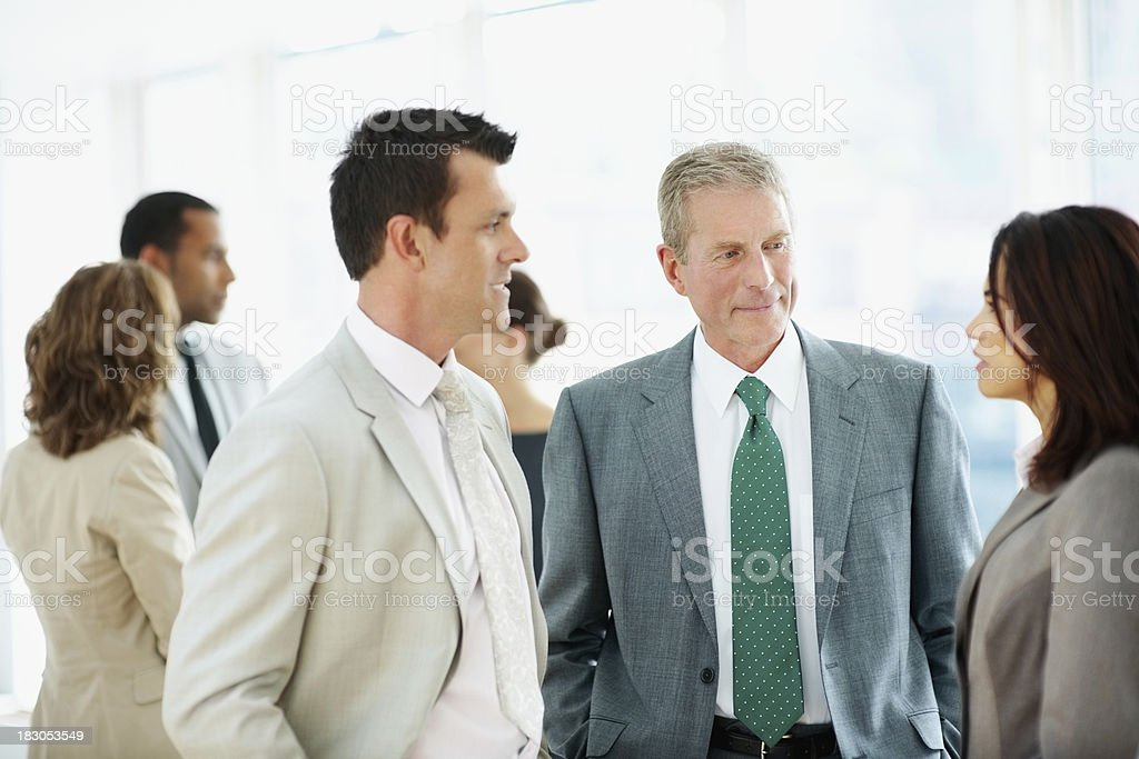 Successful business people discussing something at office royalty-free stock photo
