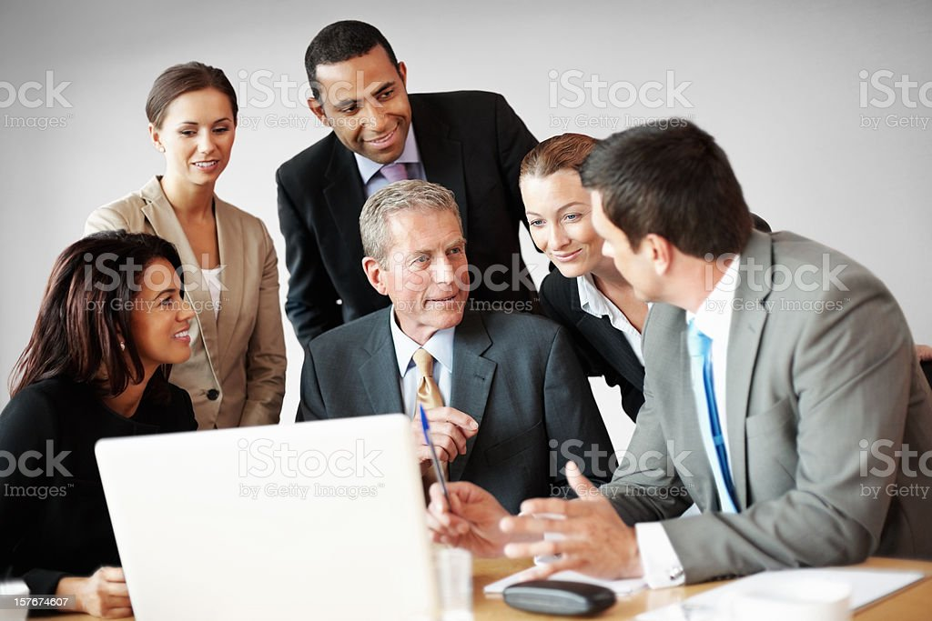 Successful business people discussing work with laptop on desk royalty-free stock photo