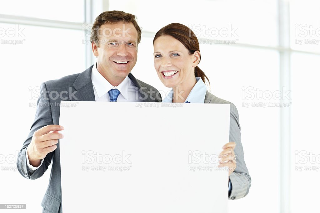 Successful business people holding an empty billboard royalty-free stock photo