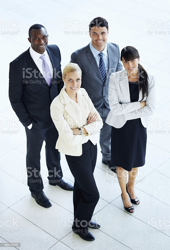 Successful business people looking at you and smiling royalty-free stock photo