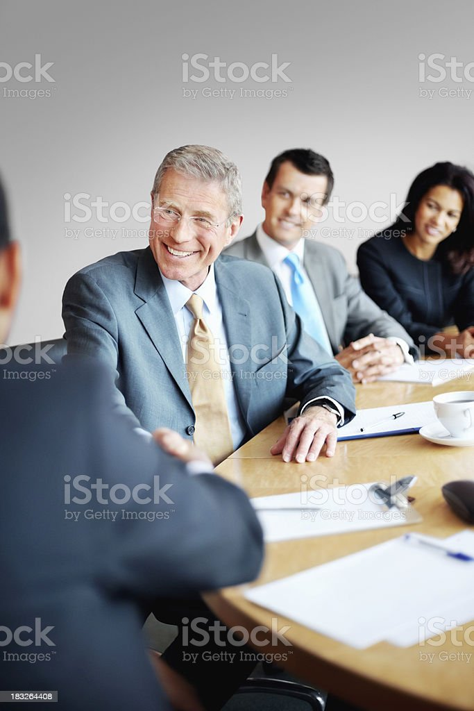 Successful business people shaking hands after a meeting royalty-free stock photo