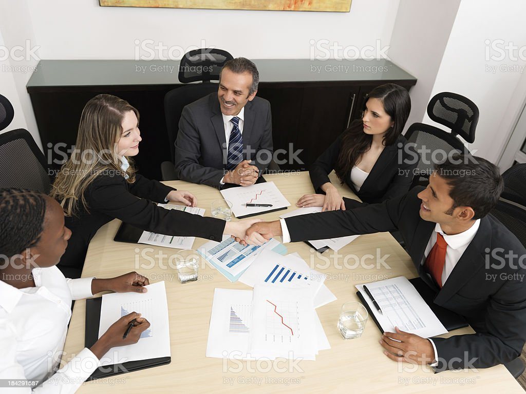 Successful business people shaking hands royalty-free stock photo