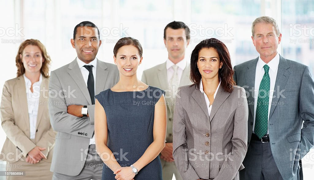 Successful business people standing together at office royalty-free stock photo