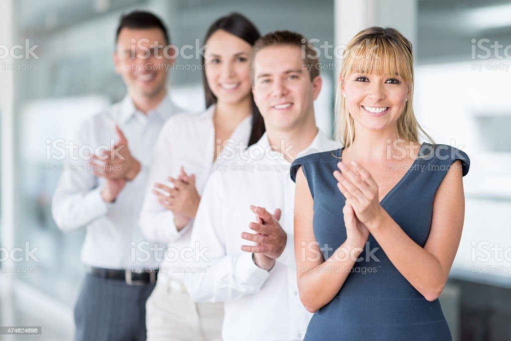Successful business team applauding stock photo