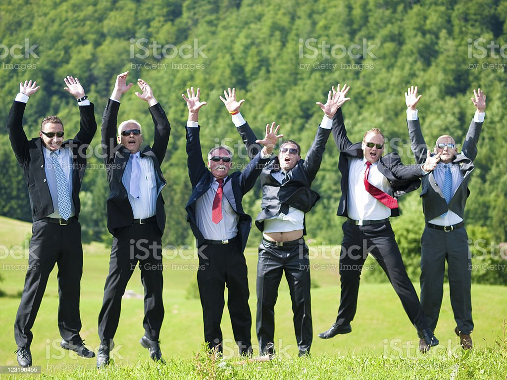 Successful Business Team Jumping And Raisinh Hands royalty-free stock photo