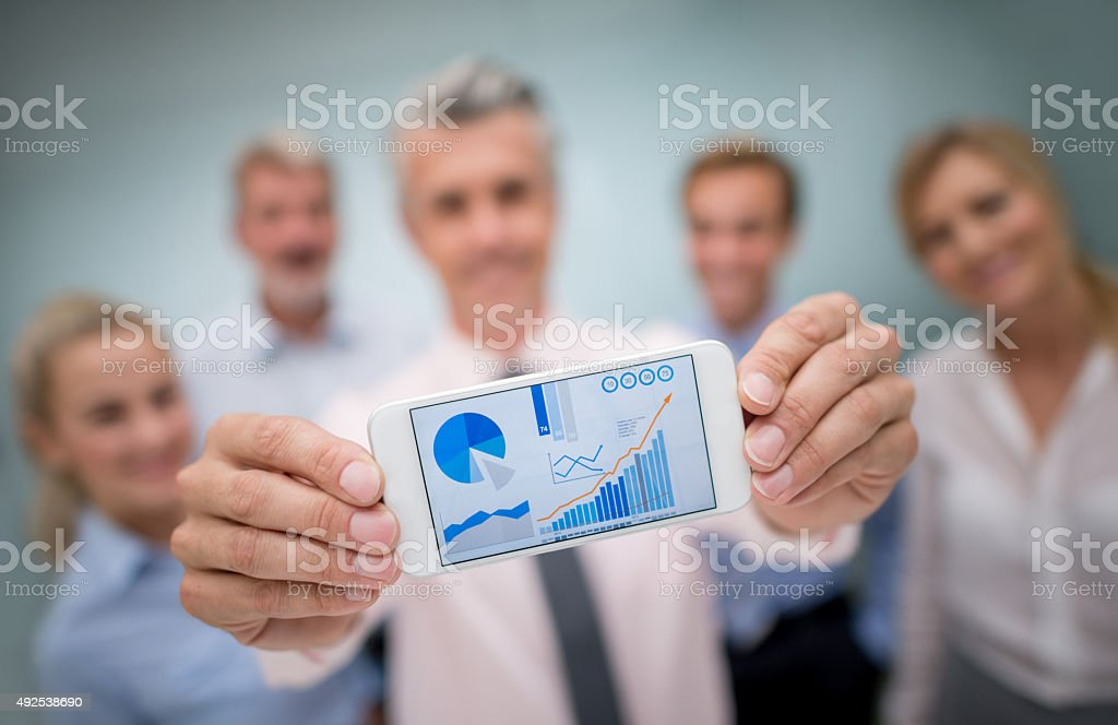 Successful business team showing online growth development stock photo