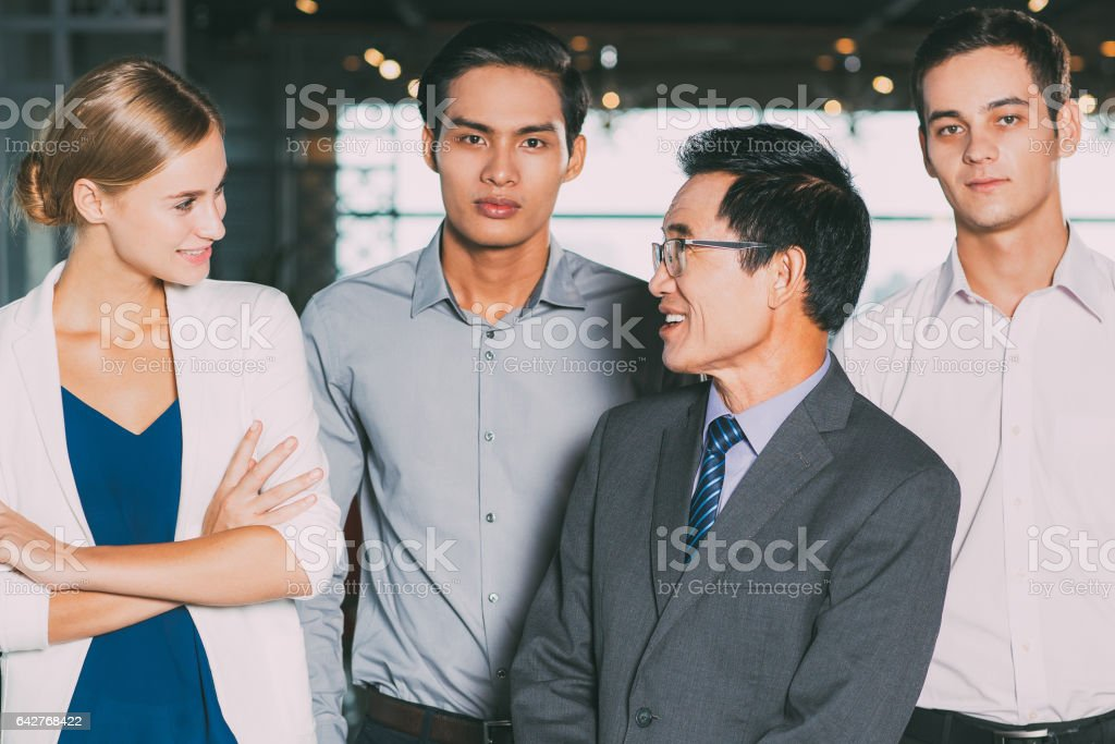 Successful Business Team Standing Together stock photo