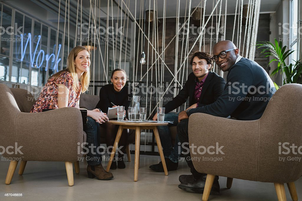 Successful business team together in office lobby stock photo