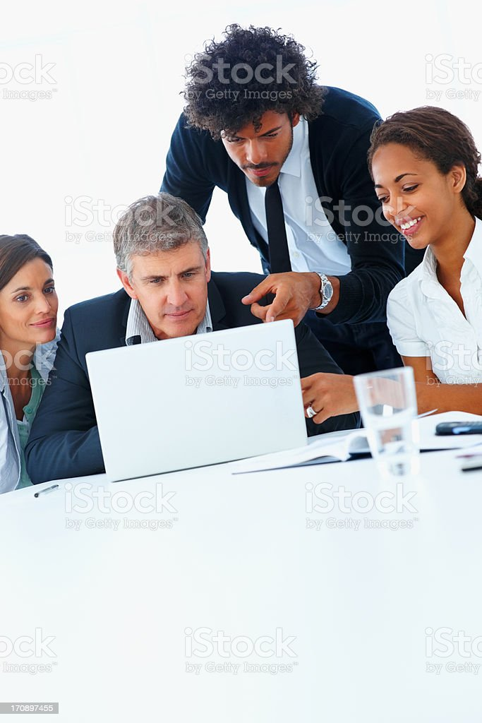Successful business team working together on a laptop stock photo