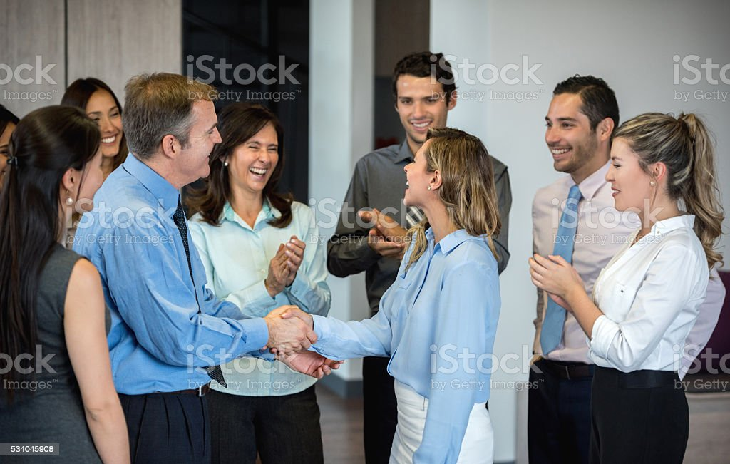 Successful business woman getting a promotion stock photo