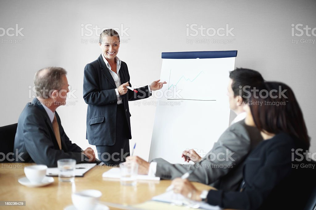 Successful business woman giving a presentation to her colleague royalty-free stock photo