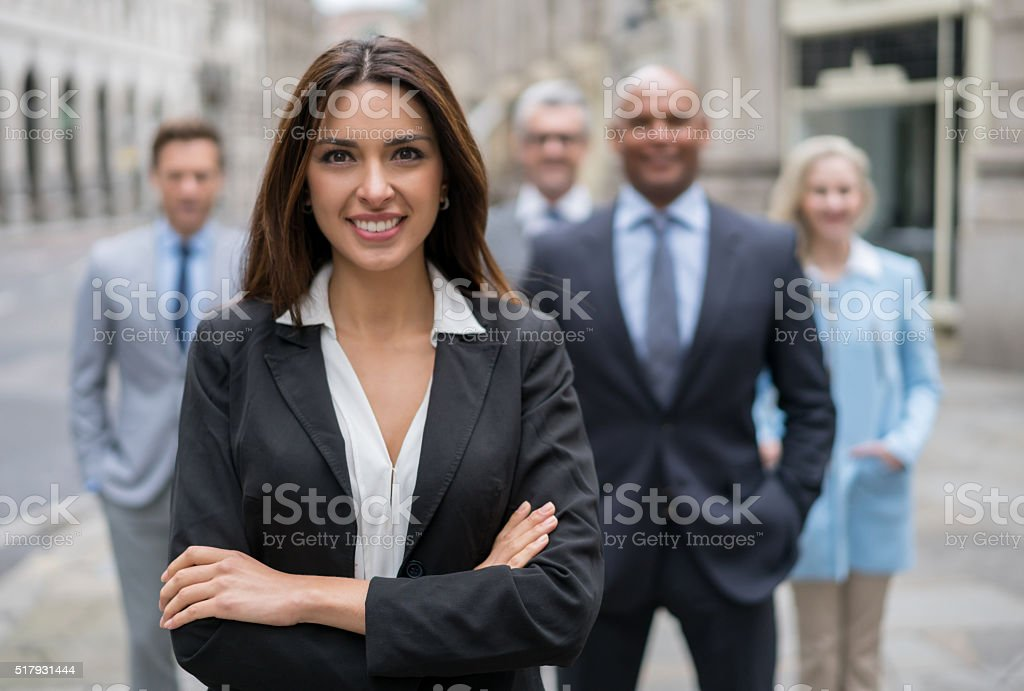 Successful business woman leading a group stock photo