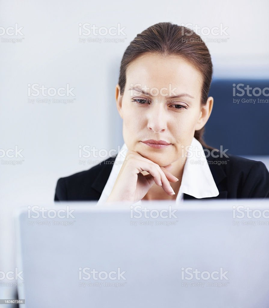 Successful business woman using a laptop at work royalty-free stock photo