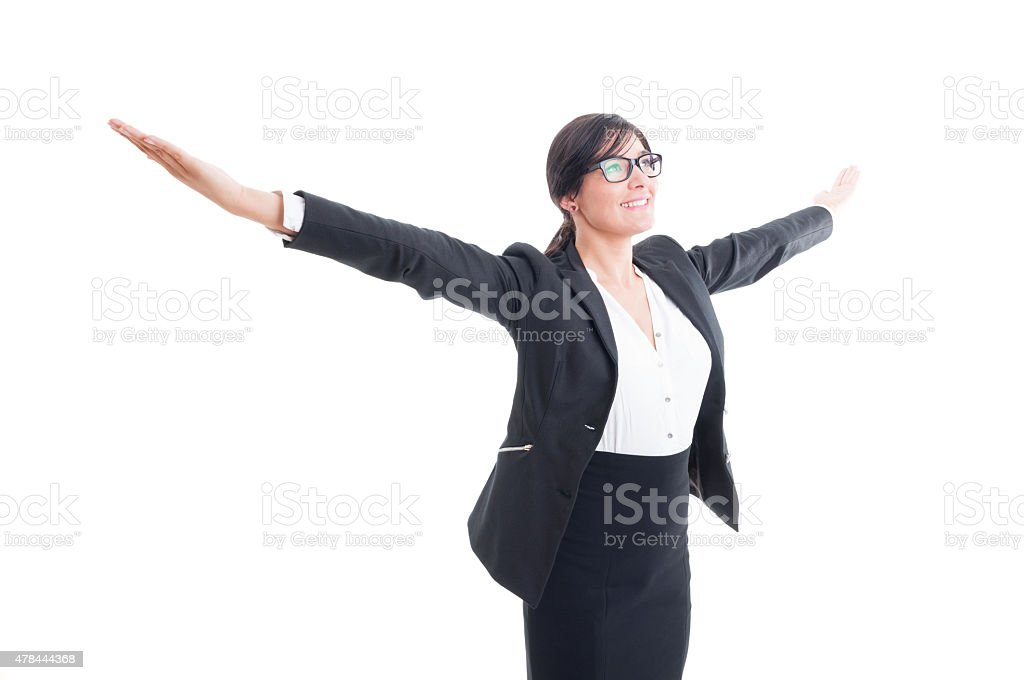 Successful business woman with arms wide open stock photo