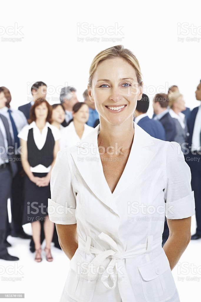 Successful business woman with colleagues at the background royalty-free stock photo