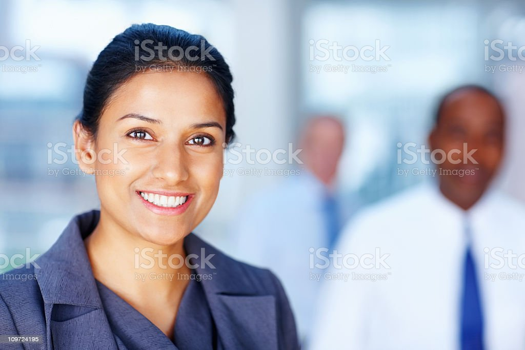 Successful business woman with team in background royalty-free stock photo