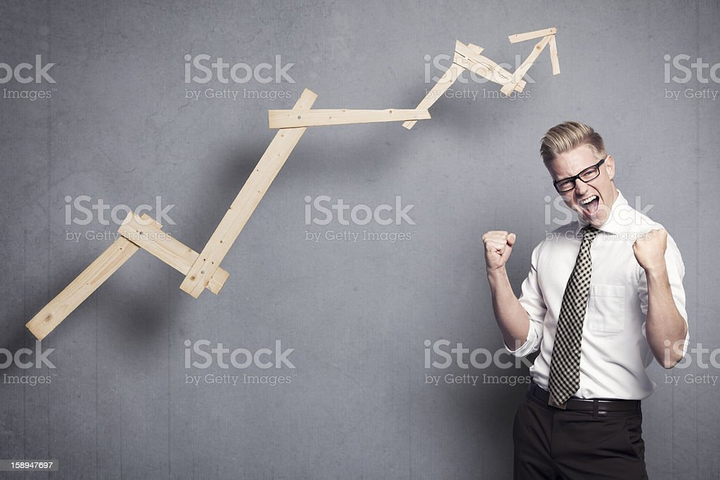 Successful businessman cheering. stock photo