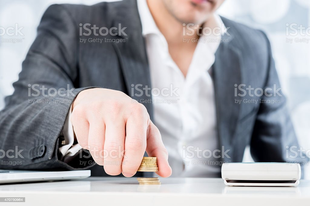 Successful businessman counting money stock photo
