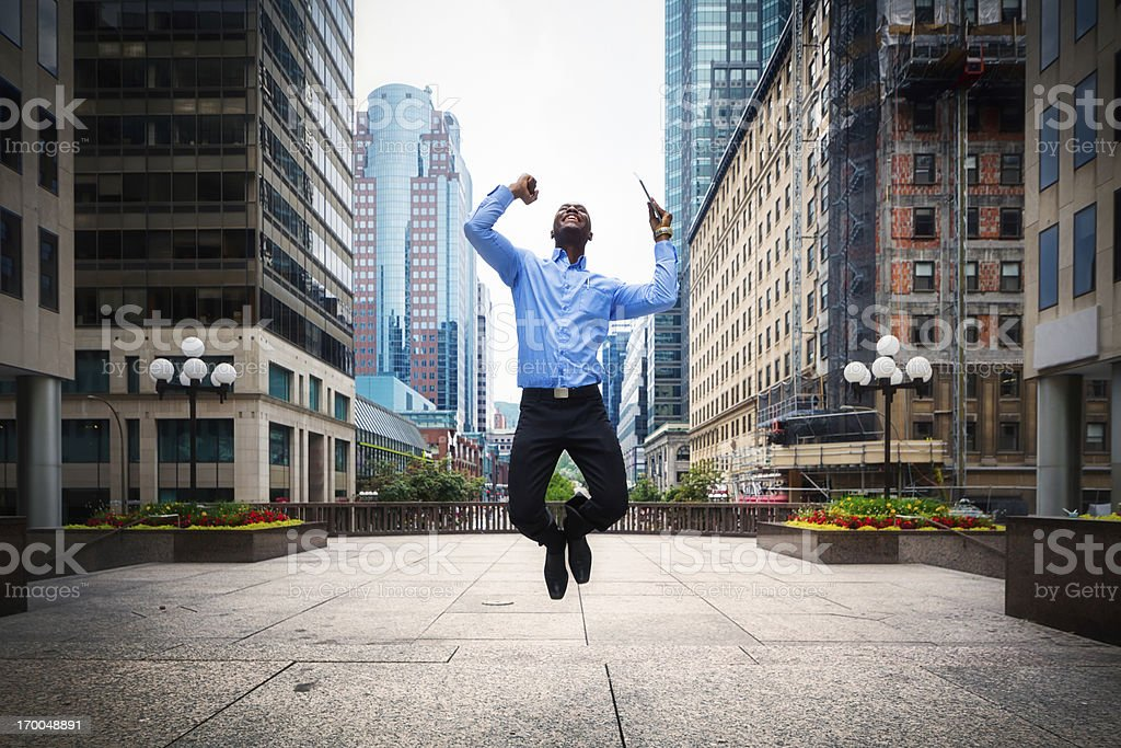 Successful Businessman jumps with joy Downtown Montreal stock photo