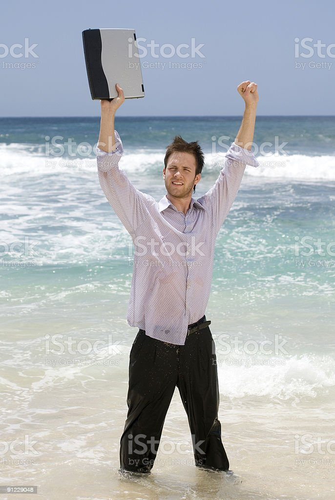Successful Businessman on the Beach royalty-free stock photo