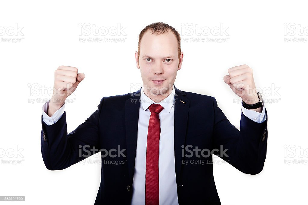 Successful businessman raising arms at workplace. isolated on white background stock photo