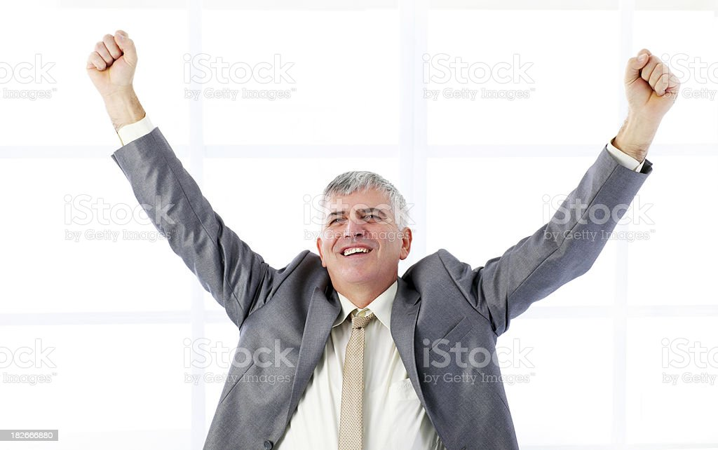 Successful businessman raising hands in the office. royalty-free stock photo