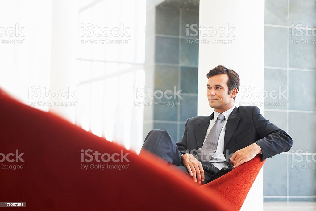 Successful businessman sitting on a sofa royalty-free stock photo