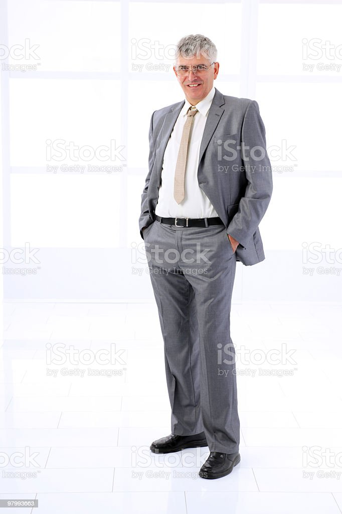 Successful businessman standing at the office. stock photo